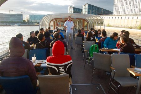 Race briefing during the river cruise